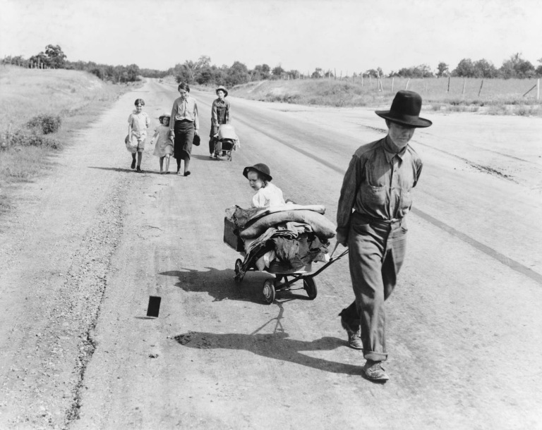 Dorothea Lange - Family walking on highway, five children. Started from Idabel, Oklahoma. Bound for Krebs, Oklahoma, 1938
